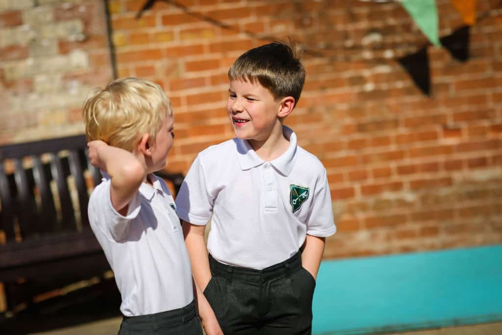 two boys in the playground laughing