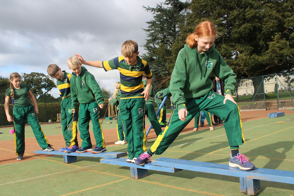 children doing an obstacle course