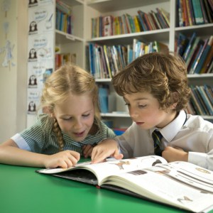 Children completing their homework in a study space