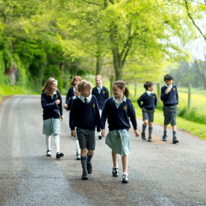 Children walking along the entrance road to St Peter's Prep school.