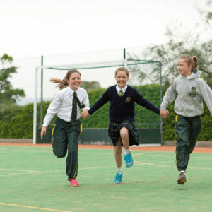 four children from St Peter's Prep school running