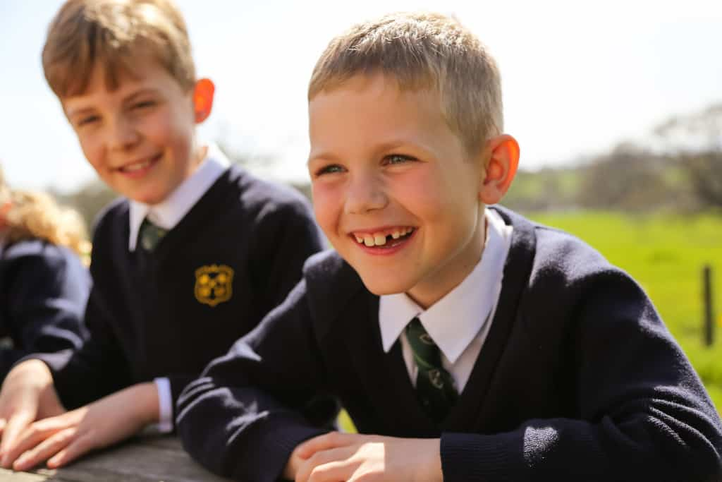 boy laughing at school