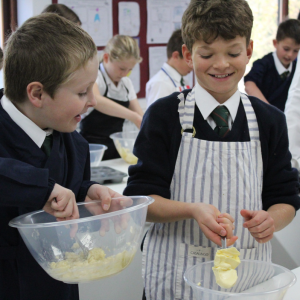 Children cooking at St. Peter's Preparatory School