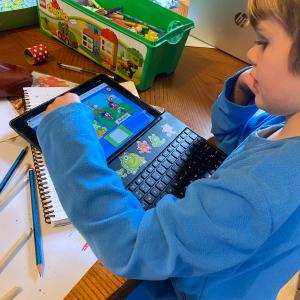 Boy on Chromebook doing remote schooling