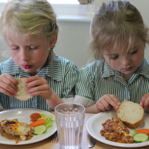 Two girls eating their lunch
